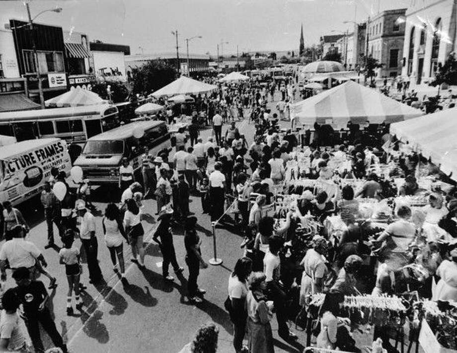 Circa 1980's - Sidewalk sale on Main Street. (Photo by Peter Kramer/The Middletown Press) Photo: Journal Register Co. / TheMiddletownPress