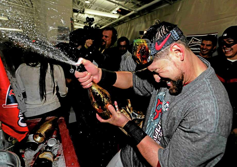 Boston Red Sox outfielder Jacoby Ellsbury went from celebrating with teammates after Game 6 of the World Series on Oct. 31 to signing with the New York Yankees on Tuesday. Photo: David J. Phillip — The Associated Press  / AP2013