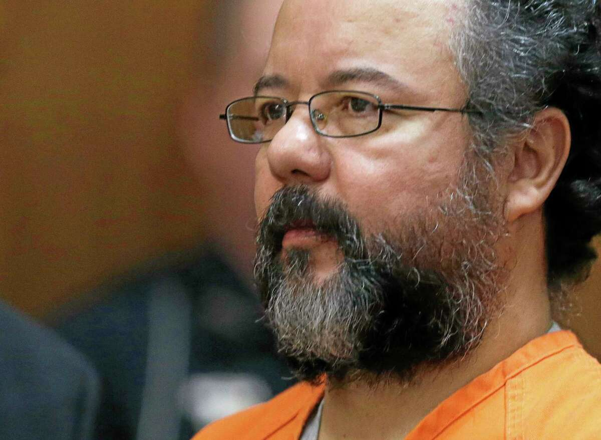 FILE - This Aug. 1, 2013 file photo shows Ariel Castro in the courtroom during the sentencing phase in Cleveland. Castro committed suicide when he hanged himself in his cell, two nationally regarded corrections consultants concluded following a review of his death released Tuesday, Dec. 3, 2013, rejecting earlier suggestions he may have died accidentally while seeking a sexual thrill. (AP Photo/Tony Dejak, File)