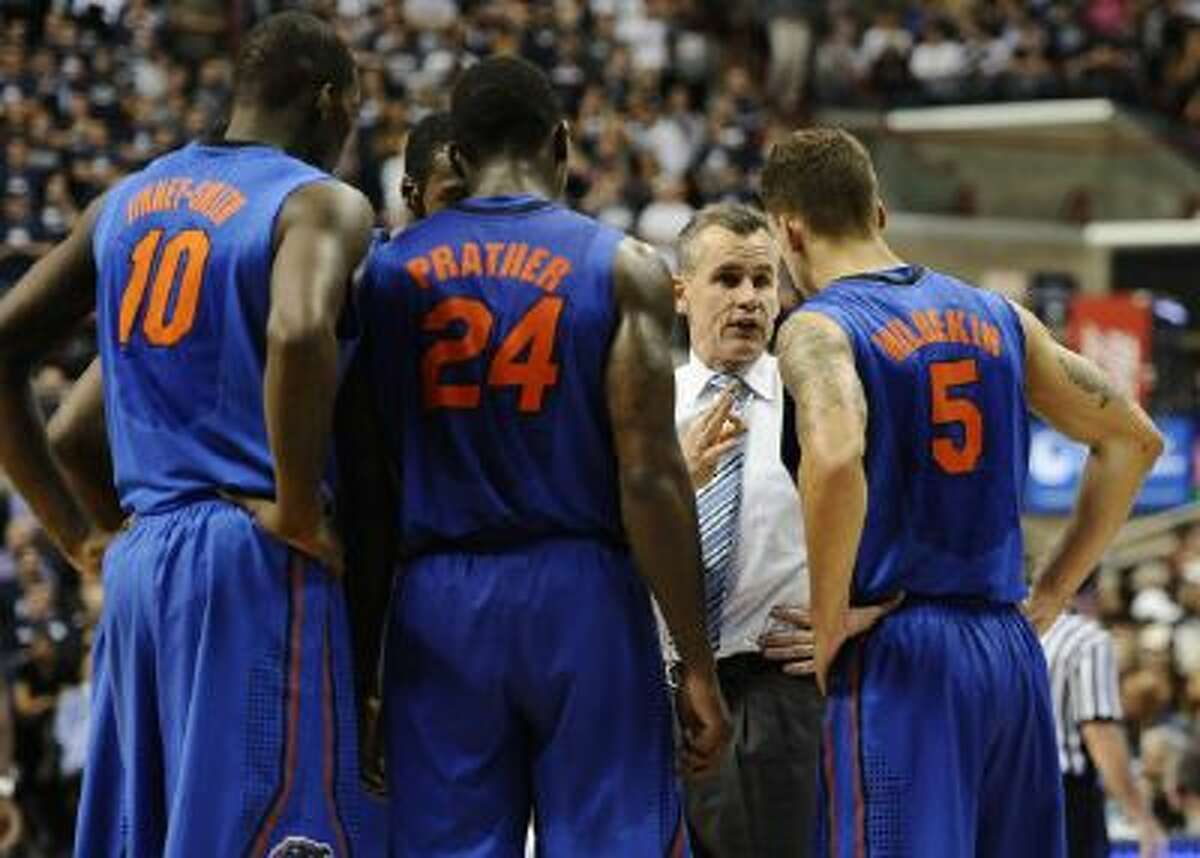Florida head coach Billy Donovan talks to his team in Monday night's loss.