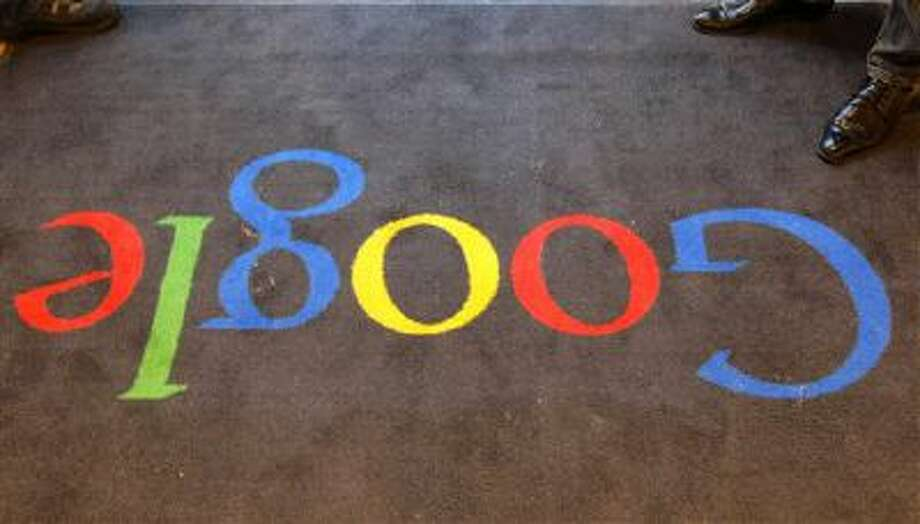 The Google logo is seen on the carpet at Google France offices, in Paris. Photo: AP / AP