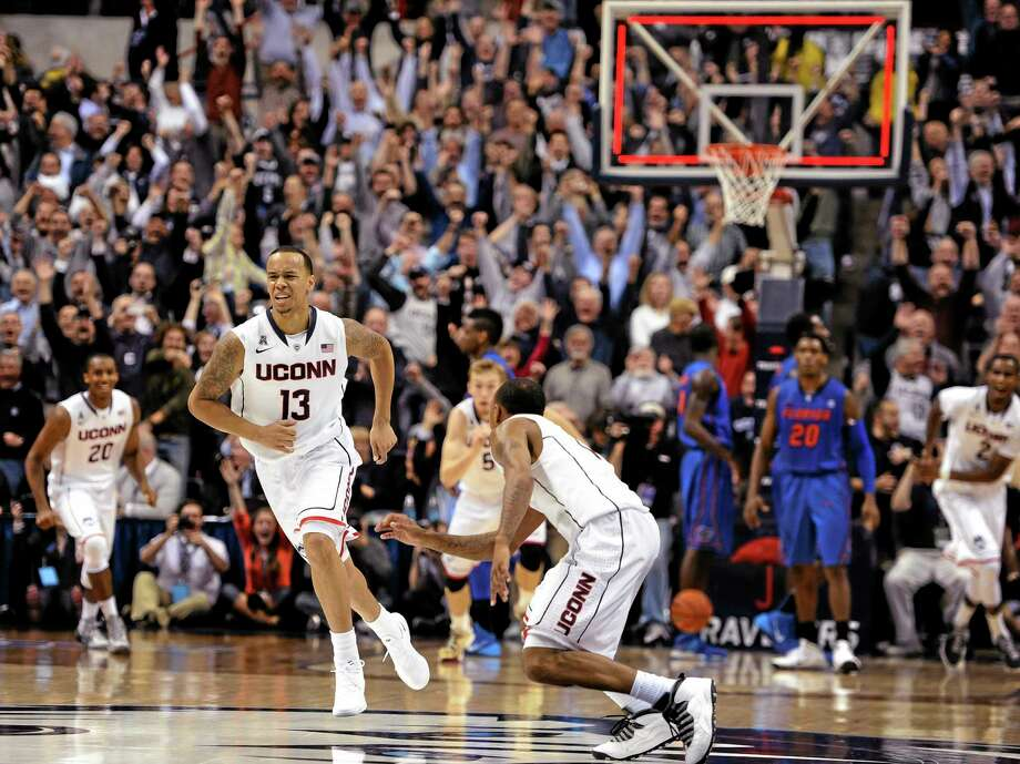 UConn's Shabazz Napier, left, and Ryan Boatright, right, react after Napier hits the game-winning basket Monday against Florida. Photo: Jessica Hill — The Associated Press  / FR125654 AP