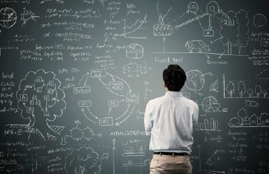 Man looking to formula and picture on blackboard Photo: Getty Images / (c) Yagi Studio