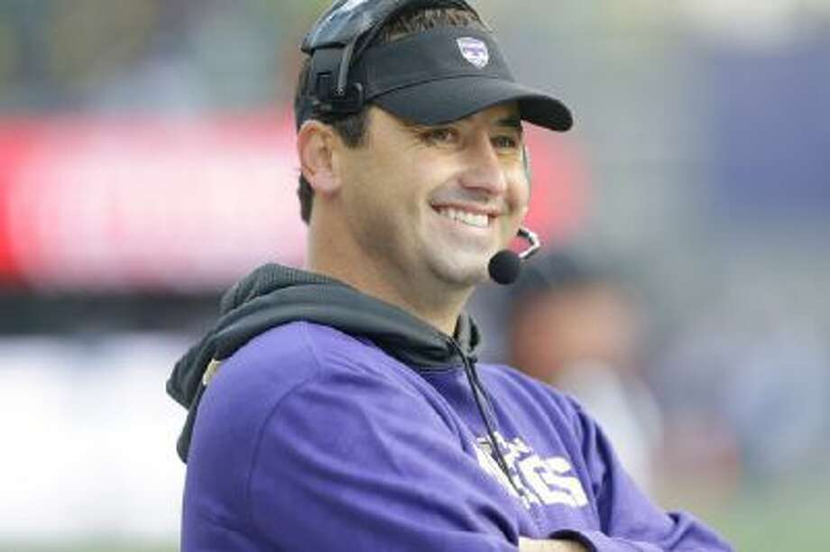 Washington head coach Steve Sarkisian smiles on the sideline during an NCAA college football game against Oregon, Saturday, Oct. 12, 2013, in Seattle.