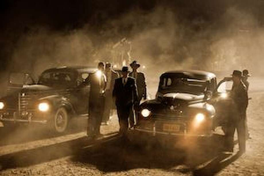 """This publicity image released by TNT shows a scene from the upcoming drama, """"Mob City,"""" a three-week television event beginning on Dec. 4, 2013."""