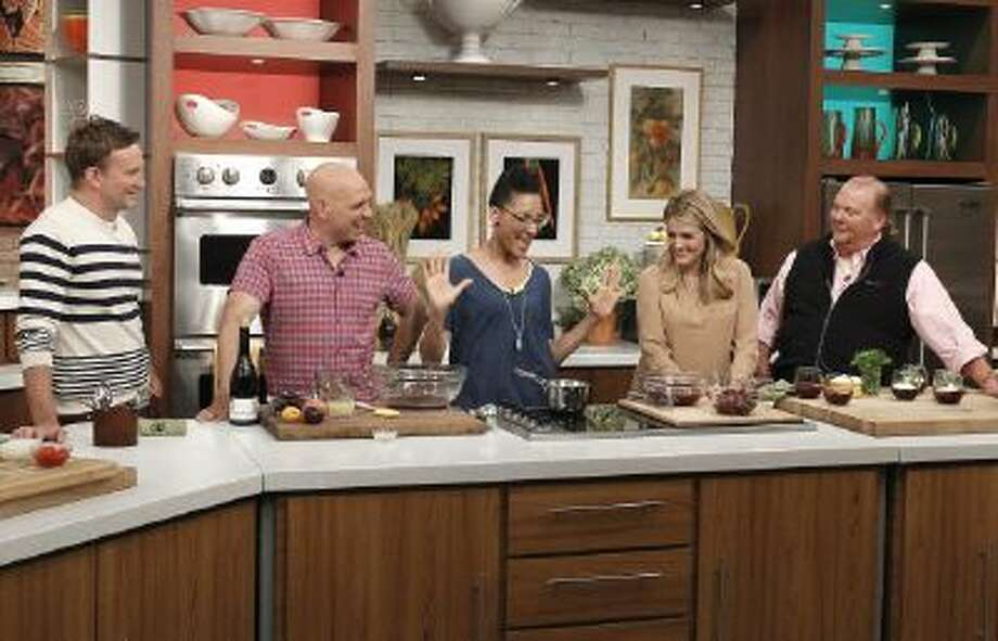 "This June 18, 2013 photo released by ABC shows hosts of ""The Chew,"" from left, Clinton Kelly, Michael Symon, Carla Hall, Daphne Oz and Mario Batali on the set in New York."