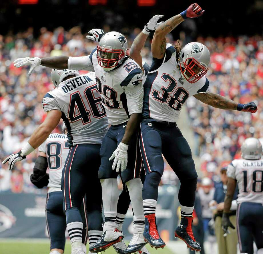 Patriots running back LeGarrette Blount (29) celebrates with teammates James Develin (46) and Brandon Bolden (38) after scoring a touchdown against the Texans Sunday. Photo: David J. Phillip — The Associated Press  / AP