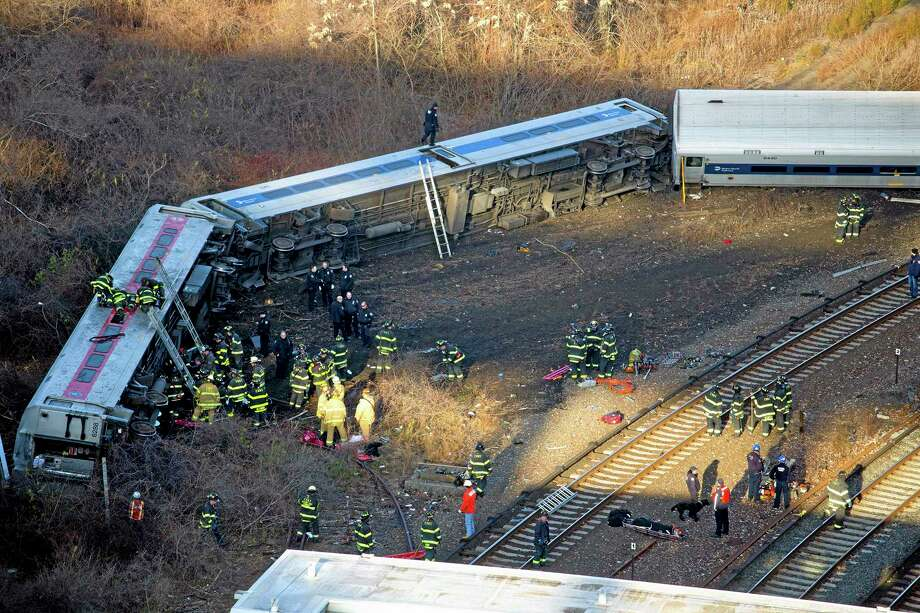 """First responders gather at the derailment of a Metro North passenger train in the Bronx borough of New York Dec. 1, 2013  The Fire Department of New York says there are """"multiple injuries"""" in the  train derailment, and 130 firefighters are on the scene. Metropolitan Transportation Authority police say the train derailed near the Spuyten Duyvil station. (AP Photo/Craig Ruttle) Photo: AP / FR61802 AP"""