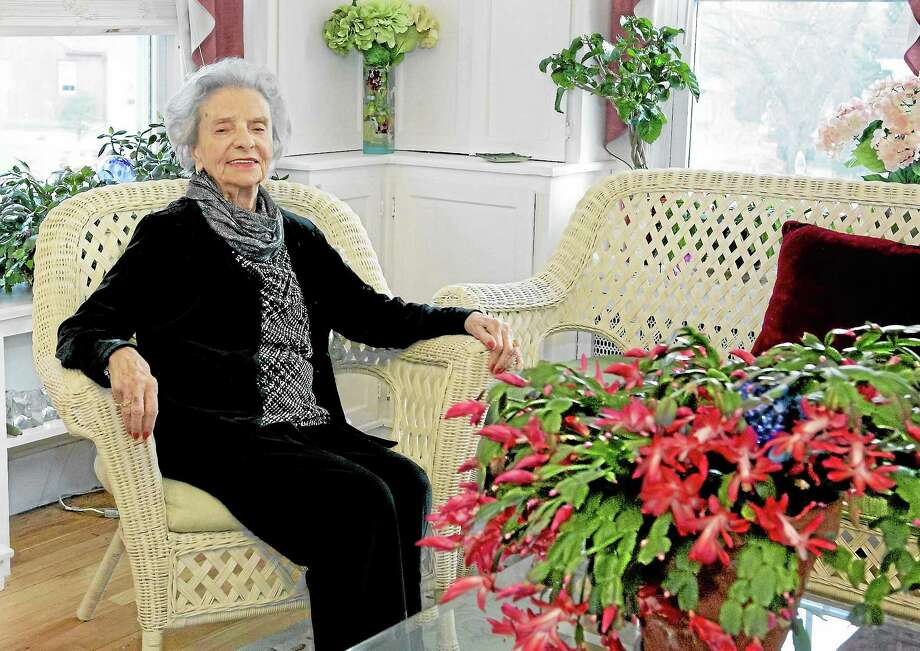 Gertrude Dunn awaits the start of her 100th birthday party in Middletown Saturday, where she celebrated with family and friends. Photo: Sandy Aldieri - Special To The Press