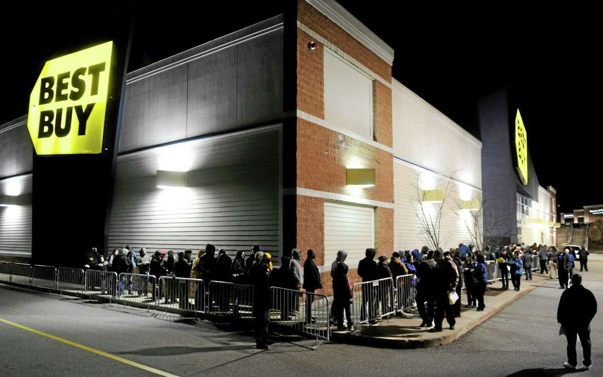 Shoppers wait in line at Best Buy in Waterford, Conn., on Thanksgiving Day, Thursday, Nov. 28, 2013. (AP Photo/The Day, Sean D. Elliot)