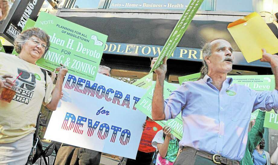 Petitioning Democratic challenger for Middletown Planning and Zoning, Stephen Devoto rallied outside of Democratic Headquarters at Main Street Market urging supporters to call voters to vote for Devoto in the primary. Devoto's rally is in response to the Facebook message from the Middletown Democratic Town Committee urging Democrats to call voters for support for one hour.  Catherine Avalone - The Middletown Press Photo: Journal Register Co. / TheMiddletownPress