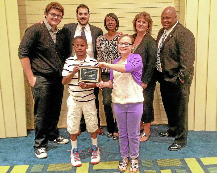 "Alex Gecan - The Middletown PressBack Row: Mark Sumner, Justin Carbonella, Felicia Goodwine-Vaughters, Joanne Jukins and police Cpt. Gary Wallace with (front row) D'Andrew Saunders and Haley Peacock accept the CTYSA Program of the Year award for ""Bigger Than You Think."" Photo: Journal Register Co."