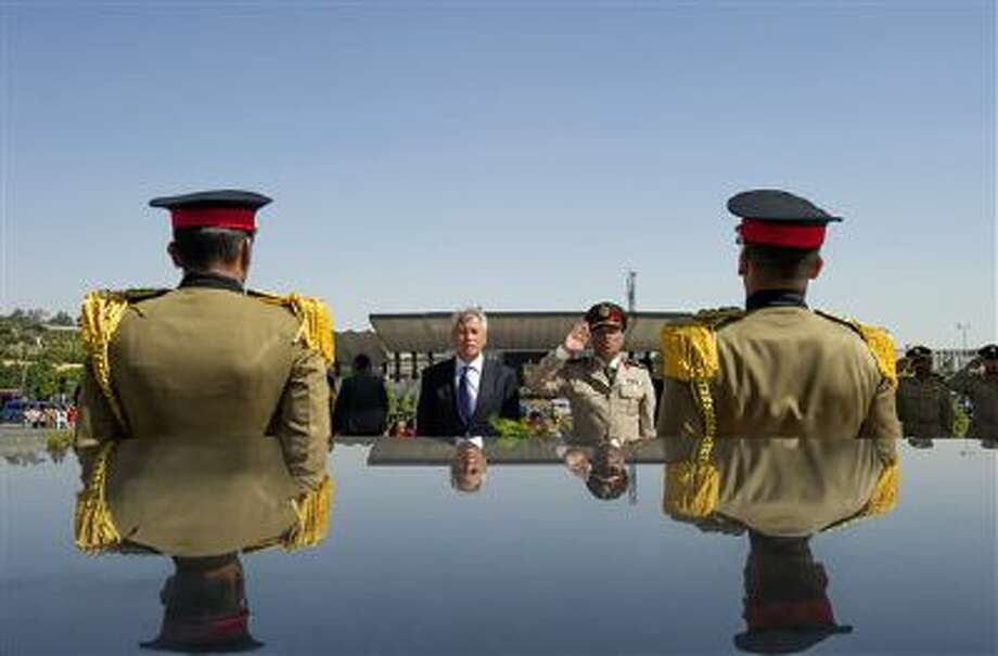 In this April 24 file photo, U.S. Secretary of Defense Chuck Hagel, second left, stands with an Egyptian army official before laying a wreath at the tomb of late President Anwar al-Sadat in Cairo. Photo: AP / Pool AFP