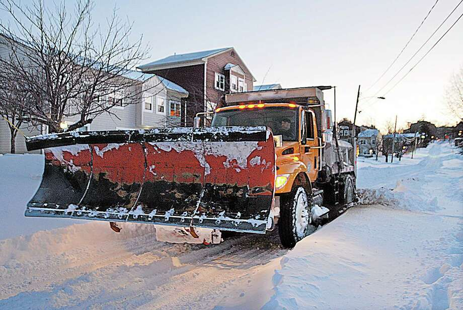 A city plow spins its wheels in this February file photo. Photo: Andrew Phillip Avalone — Special To The Press