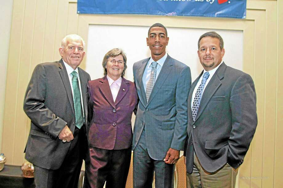 Left to Right: Larry McHugh, president, Middlesex County Chamber of Commerce, Darlene Briggs, chairwoman, Middlesex County Chamber of Commerce, Kevin Ollie, UConn head men's basketball coach, Rich Carella, vice chairman, Middlesex County Chamber of Commerce. Submitted Photo by De Kine Photo LLC Photo: Journal Register Co. / (c)dekinephotoLLC2012