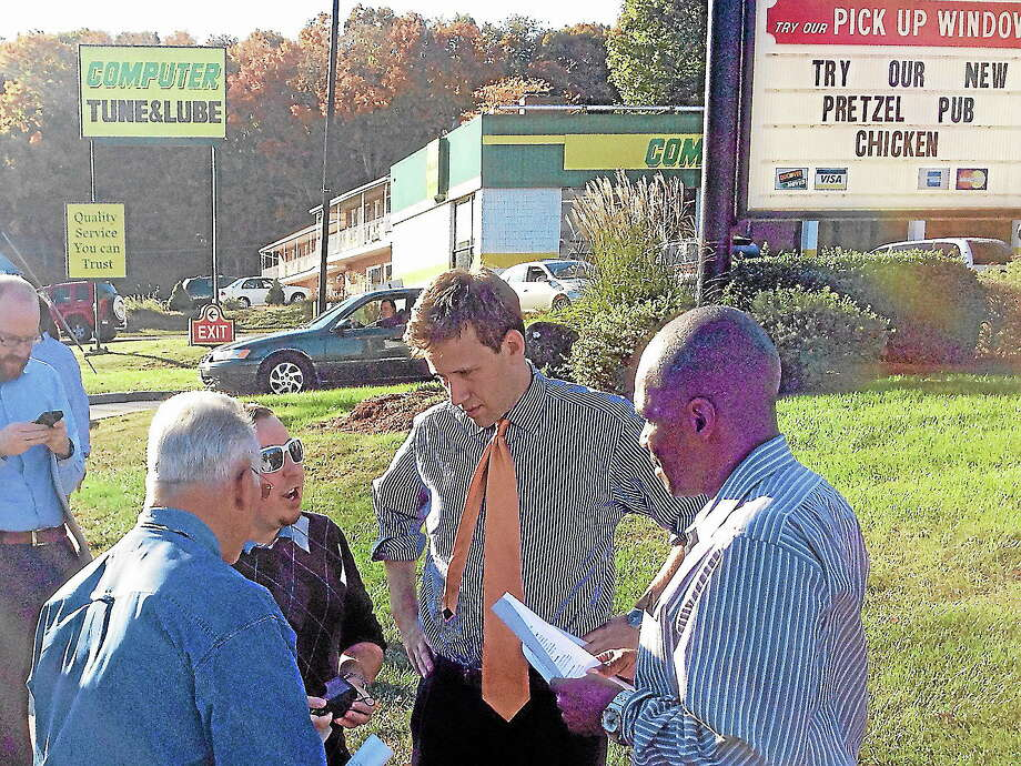Alex Gecan - The Middletown PressCouncilman Phil Pessina, Working Families Party spokesman Taylor Leake, State Rep. Matt Lesser and Planning and Zoning Commissioner Carl Chisem discuss wages in the fast food industry outside Wendy's on Washington Street Tuesday. Photo: Journal Register Co.