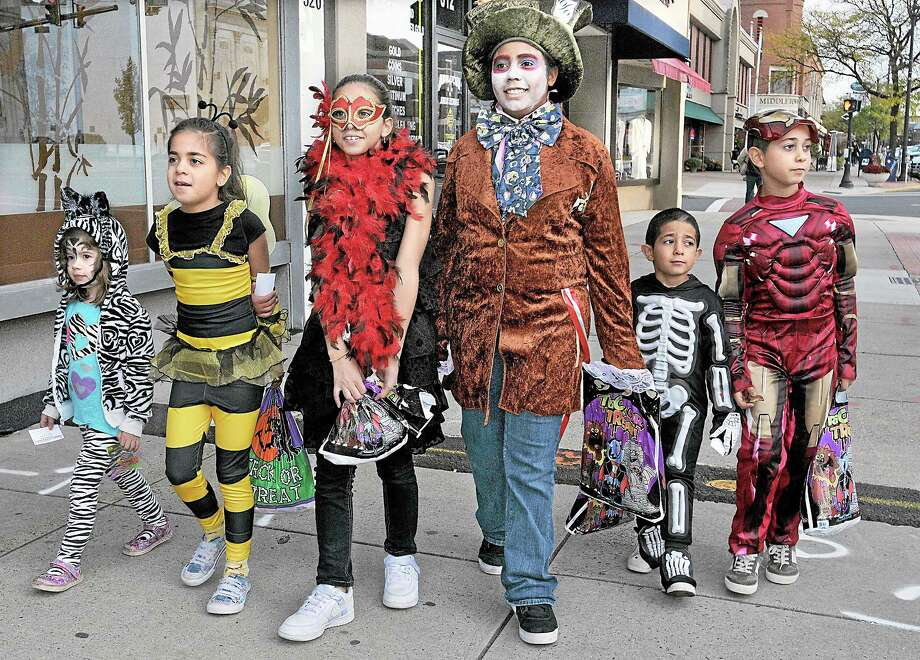 Middletown residents Madeline Bortz, 4 , the zebra, Alana Boirie, 8, the bumble bee, Brianna Boirie, 11, the flapper, Ajah Boirie, 12, the Mad Hatter, Bryan Boirie, 5, the skeleton, and Ivan Boirie, 9, as the Iron Man are decked out in 2011 for the Trick or Treat Downtown Photo: Catherine Avalone - The Middletown Press