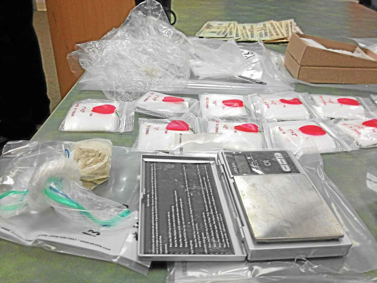 Following surveillance, police seized multiple bags of heroin, cash, drug paraphernalia and more from a Cromwell home.