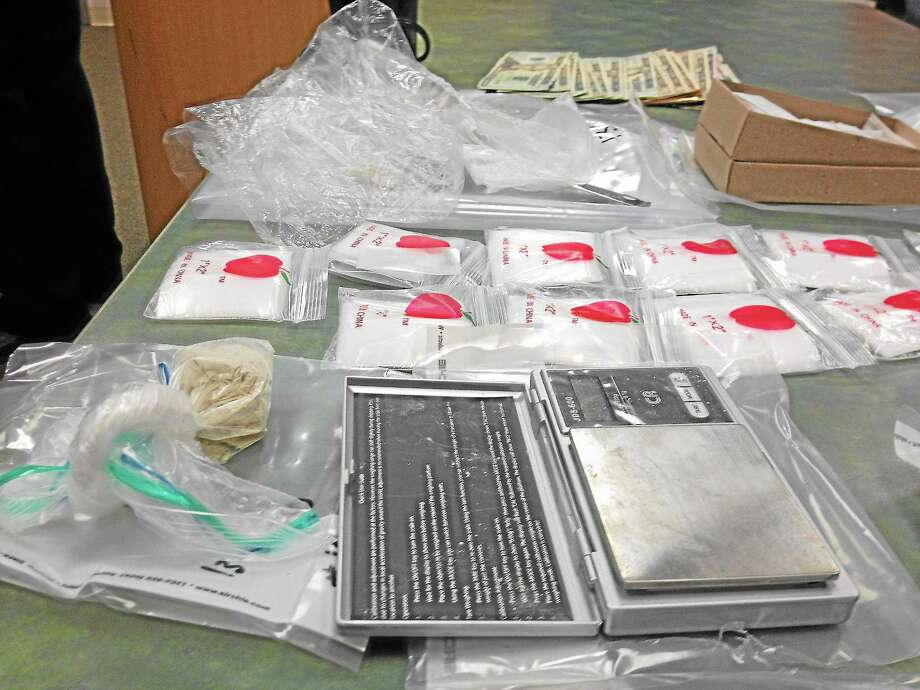 Following surveillance, police seized multiple bags of heroin, cash, drug paraphernalia and more from a Cromwell home. Photo: Alex Gecan - The Middletown Pres