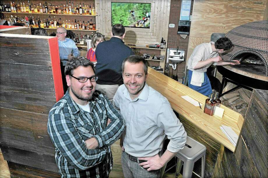 Kevin Wirtes, left, and Rich Garcia, co-owners of Krust Wood-Fired Pizza and Bourbon Bar at 686 Main St. in Middletown will be expanding, adding 40 to 50 seats. Photo: Catherine Avalone - The Middletown Press / TheMiddletownPress