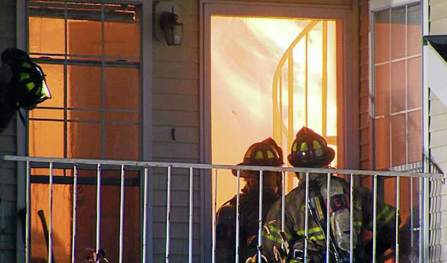 Firefighters from several departments respond to a fire at Carriage Crossing condominiums off West Lake Drive in Middletown Monday night. It was the first of two fires that kept firefighters busy into the morning hours Tuesday. Photo: Tom Parent - WTNH 8