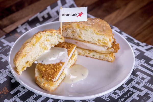 Chicken Biscuit (NRG Stadium): Hand-battered, corn flakes crusted  chicken breast topped with a creamy, white gravy, served open faced, on  a homemade jalapeno, chive and cheddar cheese infused buttermilk  biscuit.