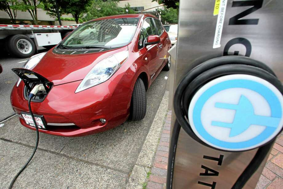 A Nissan Leaf charges at an EV charging station. Photo: AP File Photo  / AP