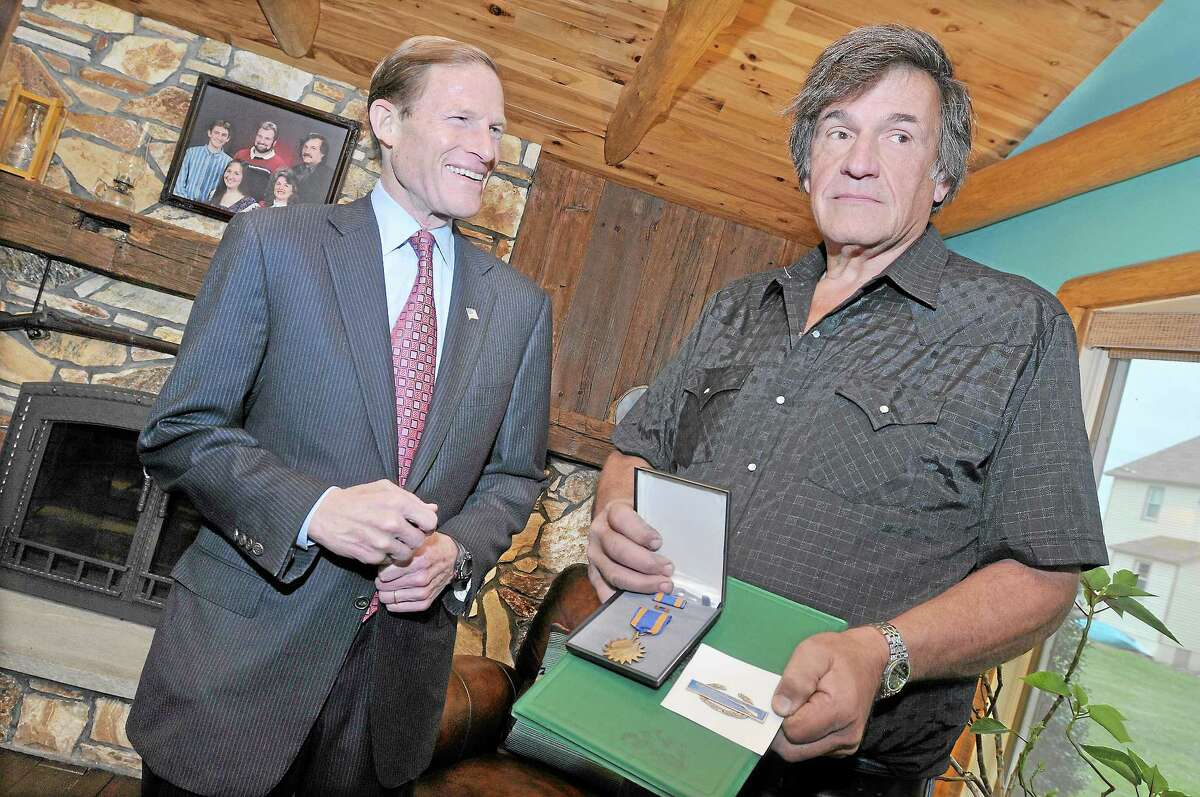 Middletown resident Harold E. Graves, Jr. finally received two long delay decorations he earned in Vietnam 1969-1970. The Combat Infantryman Badge and Air Medal on were delivered to Graves on Veterans Day by Richard Blumenthal. Catherine Avalone - The Middletown Press