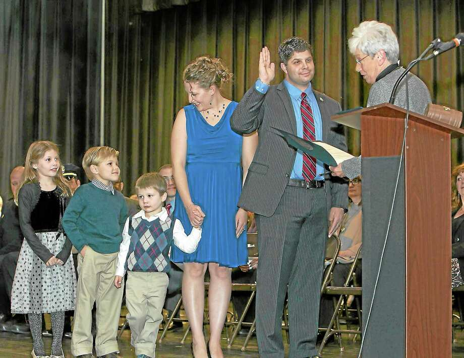 Sandy Aldieri - special to the press Mayor Dan Drew takes the oath of office. Photo: Journal Register Co.
