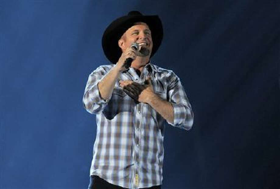 This April 7, 2013 file photo shows Garth Brooks performing at the 48th Annual Academy of Country Music Awards in Las Vegas, Nev. Photo: Chris Pizzello/Invision/AP / Invision