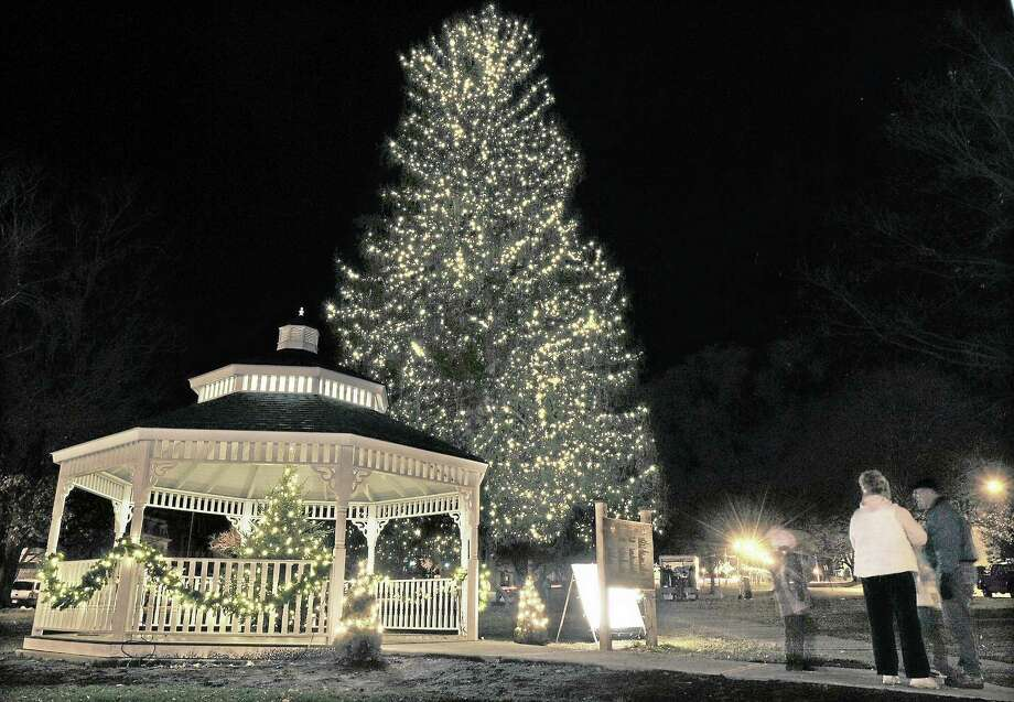"Holiday on Main Street will kick off Friday on Middletown's South Green with caroling at 5 p.m. by local school children and the annual tree-lighting ceremony at 5:45 p.m. The 85-foot tree is decorated with white lights; a small Christmas tree centered in the Veterans memorial gazebo is decorated by the Middlesex Hospital Hospice & Palliative Care Program, ""shining a light in honor or in memory of friends and loved ones."" Photo: Catherine Avalone - The Middletown Press   / TheMiddletownPress"