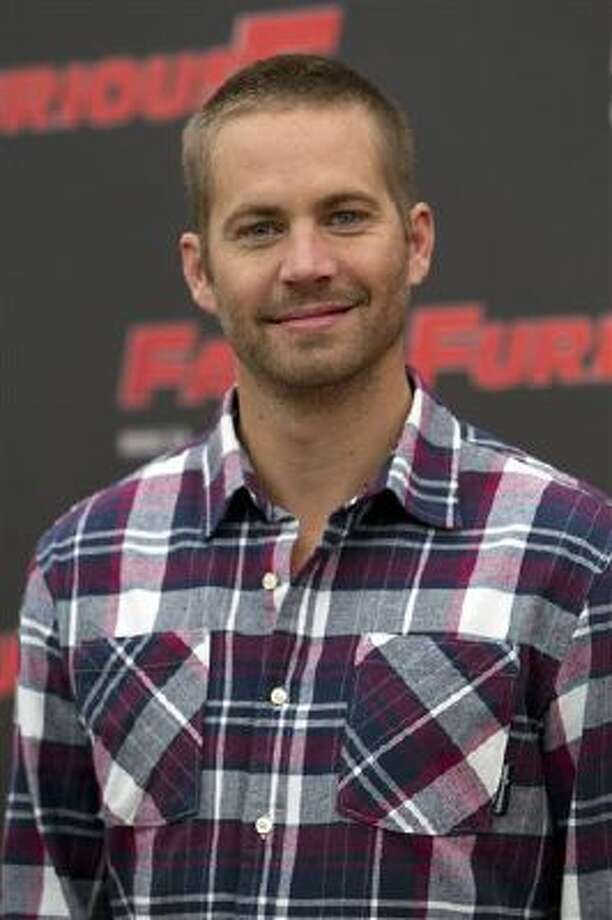 "In this April 29, 2011 file photo, actor Paul Walker poses during the photo call of the movie "" Fast and Furious 5,"" in Rome. Photo: AP / AP"