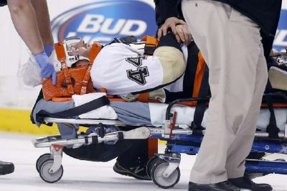 Pittsburgh Penguins' Brooks Orpik is taken off the ice after an injury against the Boston Bruins.