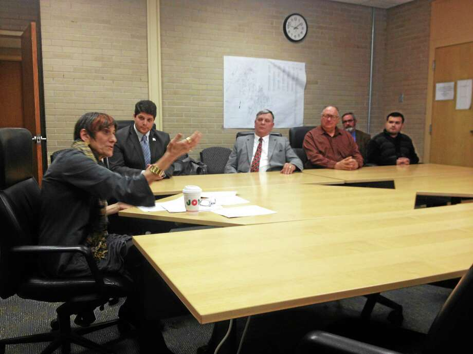 Congresswoman Rosa DeLauro (left) with Middletown Mayor Daniel Drew, Tom Knowlton of Wallingford, Rich Faraci of Portland, Robert Fort (in back) of the Workforce Alliance, and Felix Pagan of Middletown, discuss the expiration of emergency unemployment benefits. Photo: Alex Gecan - The Middletown Press