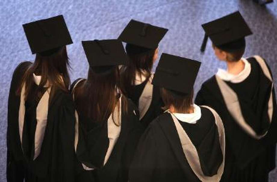 BIRMINGHAM, ENGLAND - JULY 14: Students at the University of Birmingham take part in their degree congregations as they graduate on July 14, 2009 in Birmingham, England. Over 5000 graduates will be donning their robes this week to collect their degrees from The University of Birmingham. A recent survey suggested that there are 48 graduates competing for every job. (Photo by Christopher Furlong/Getty Images) Photo: Getty Images / 2009 Getty Images