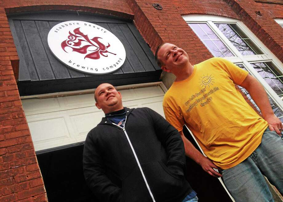 Andrew Daigle, left, and Shane Lentini hope to open their Stubborn Beauty Brewing Company at the Remington Rand building by early February. Photo: Alex Gecan — The Middletown Press