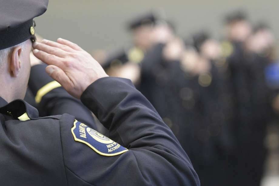 An Albany police officer salutes in the this undated file photo. Photo: Skip Dickstein / Times Union