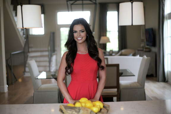Logan Lester, a realtor and Miss Houston 2016, shows a home during an open house on Tuesday, Aug. 15, 2017, in Houston.  ( Elizabeth Conley / Houston Chronicle )