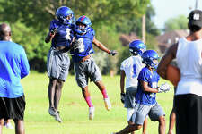 West Brook players celebrate during the Bruin's first practice on Monday. Photo taken Monday, August 14, 2017 Guiseppe Barranco/The Enterprise
