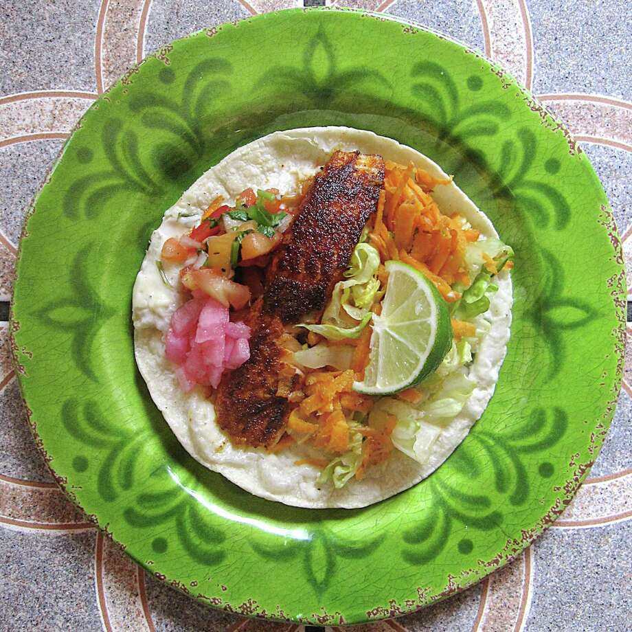 Taco of the Week: Baja salmon taco on a corn tortilla from El Siete Mares. Photo: Mike Sutter /San Antonio Express-News