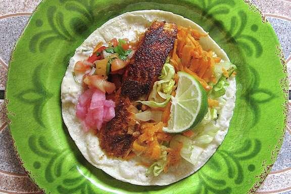 Baja salmon taco on a corn tortilla from El Siete Mares.