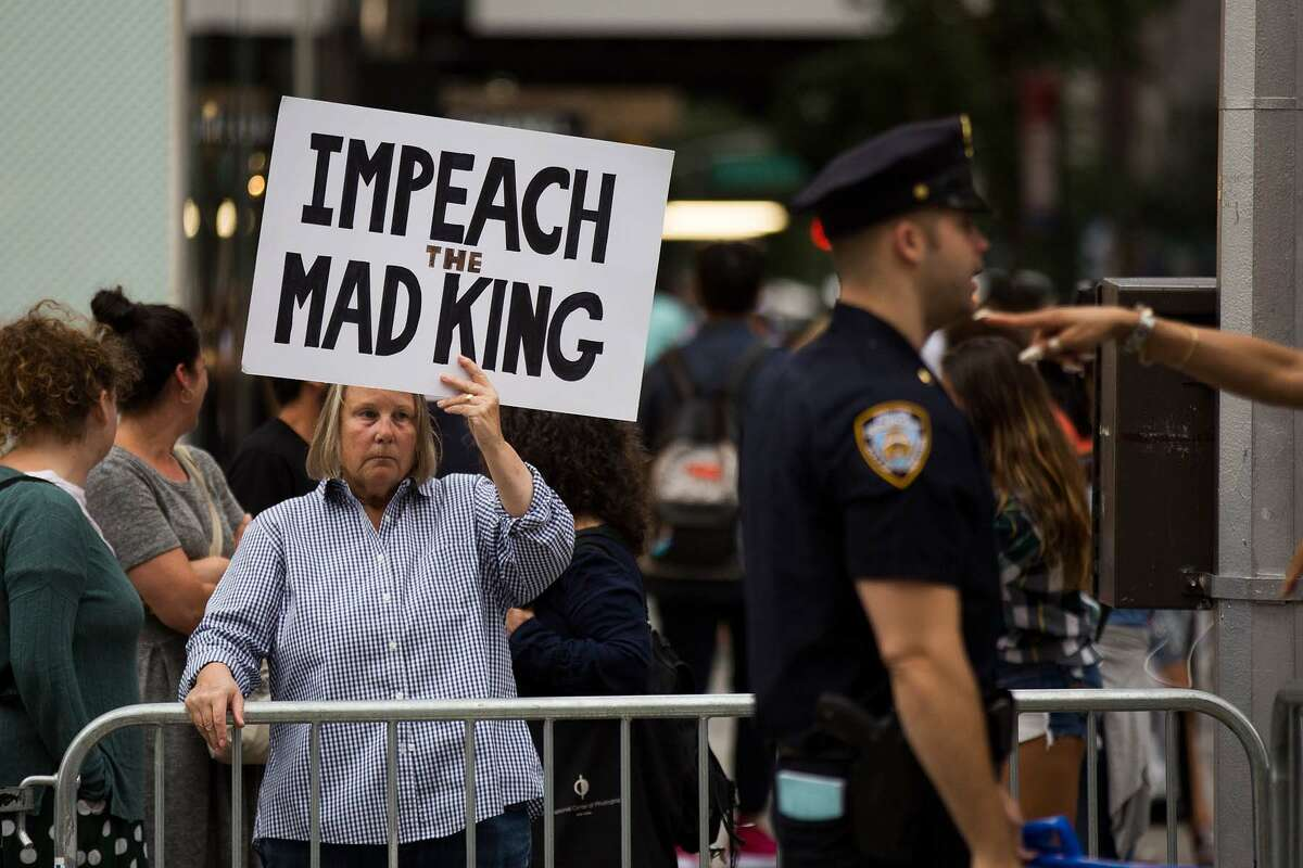 Protestors rally on Fifth Avenue near Trump Tower ahead of President Donald Trump's arrival, August 14, 2017 in New York City. See more signs from protests from around the country since the violence in Charlottesville, Virginia...