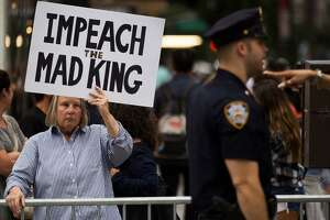 NEW YORK, NY - AUGUST 14: Protestors rally on Fifth Avenue near Trump Tower ahead of President Donald Trump's arrival, August 14, 2017 in New York City. Numerous protests are expected throughout the city today as President Trump is expected to arrive this evening at his home at Trump Tower, which will be his first visit back to his 5th Avenue apartment since the inauguration. (Photo by Drew Angerer/Getty Images)