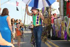 Beads, pirates, candy, floats, children laughing, and of course, cheeseburgers, filled the streets of downtown Caseville for the Annual Parade of Fools on Wednesday