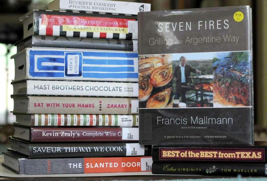 Stash of cookbooks from the San Antonio Public Library's BookCellar. Photo: Paul Stephen / San Antonio Express-News
