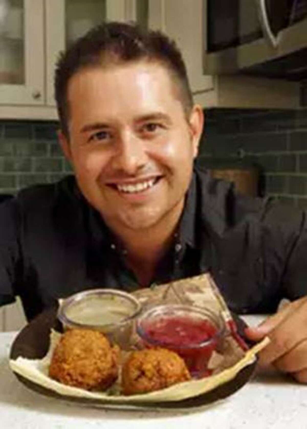 """Justin Martinez, who lives in Arlington and has a career in real estate, is a three-time winner of the """"most creative"""" award at the Big Tex Choice Awards. He won in 2013 with his Fried Thanksgiving Dinner balls (pictured). This year, he is in the hunt for best overall for his Tamale Donut. His father Rudy was born and raised in San Antonio and has been a fixture at the State Fair of Texas since 1978."""