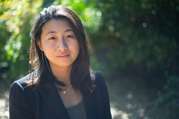Jane Huang poses for a photograph at her rental home in Palo Alto, Calif. on Tuesday, Aug. 15, 2017. Huang grew up in Palo Alto and makes six figures but still cannot live without roommates.