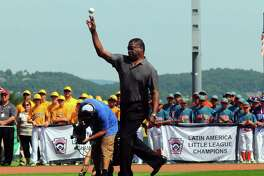 Former Major League Baseball first baseman Eddie Murray, who played with the Baltimore Orioles, throws out the ceremonial first pitch during the Little League World Series Opening Ceremonies at Volunteer Stadium in South Williamsport, Penn., on Thursday Aug. 17, 2017. The LLBWS Opening Ceremonies ushers in 10 days of baseball action at the Little League International Complex located in South Williamsport, Penn. The Opening Ceremonies is highlighted by the Parade of Champions, where the 16 teams participating in the Series parade in front of enthusiastic family, friends and fans.