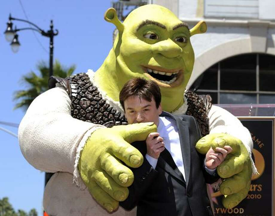 """Shrek"" is joined by actor Mike Myers as the character receives a star on the Hollywood Walk of Fame in Los Angeles May 20. Myers provides the voice of Shrek in the animated film franchise. (AP) Photo: AP / AP"