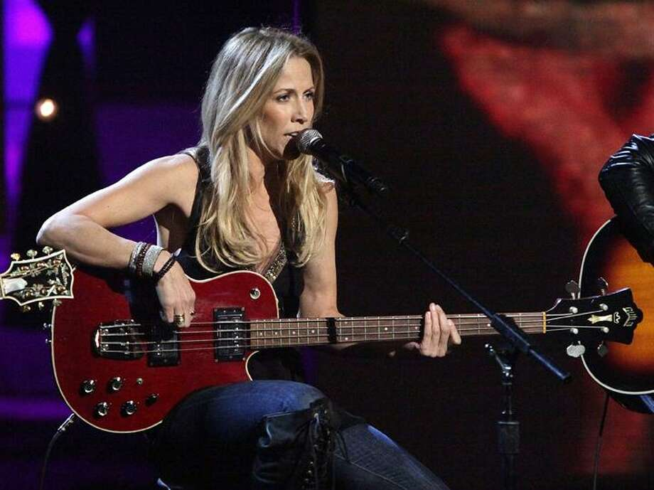 """In this image released by Hope for Haiti Now, Sheryl Crow performs at """"Hope for Haiti Now: A Global Benefit for Earthquake Relief,"""" on Friday, Jan. 22, in Los Angeles. (AP) Photo: AP / 2010 MTV Networks"""